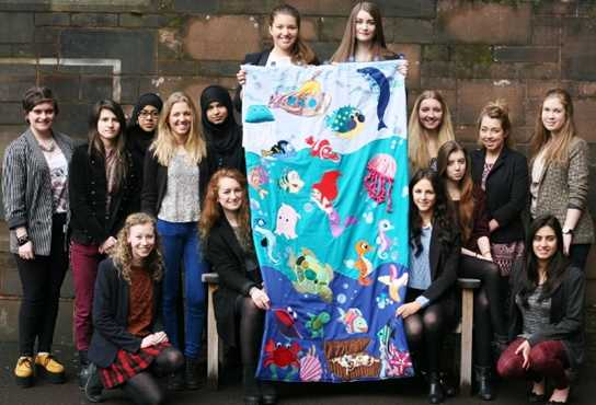 The finished wall hanging will be presented by some of the Sixth Form girls who worked on the project