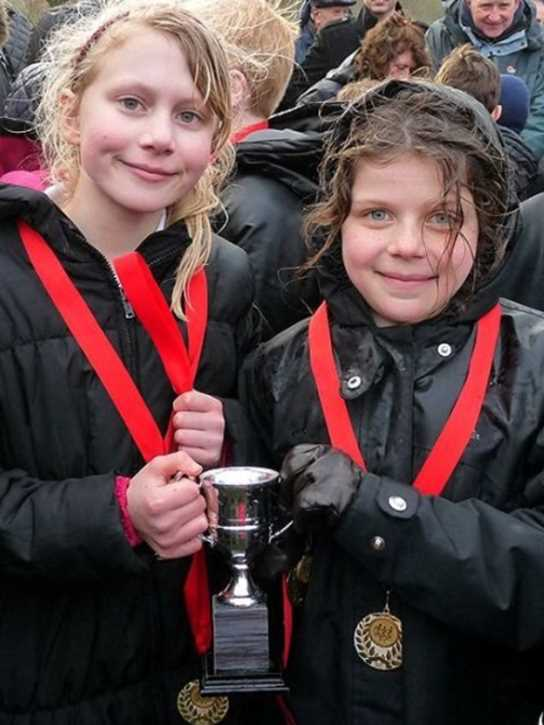 Isabella and Anna with the Year 3/4 team's Championship trophy
