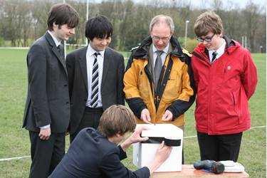 Technology and Electronics students seal the box with Mr Walker, Head of Technology