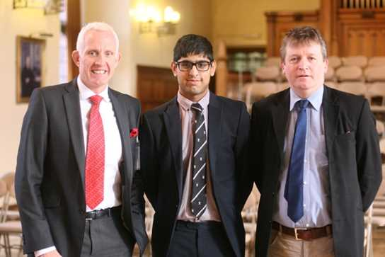 Mark Brocklehurst is welcomed by Waqqas Patel, Head Boy, and Mr Caspar Joseph, Head of the Boys' Division Sixth Form