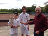Oliver and Tom receive their trophy from Alan Price