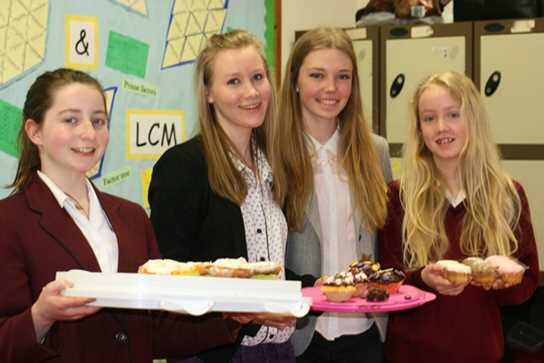 The Year 7 girls were assisted by Sixth Form charity representatives