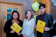 Debbie Dowie hands out awards to Waqqas Patel and Hayley Wilding
