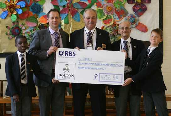 Pupils presented the cheque to the RNLI in their assembly