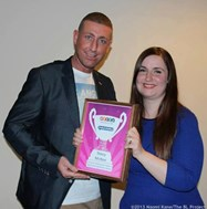 Stacy receiving her award from Christopher Maloney from X Factor 2012