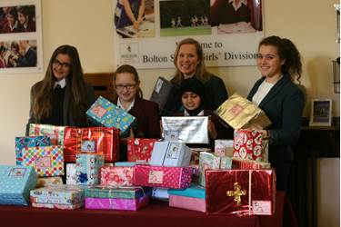 The girl's with Textile Technology teacher Sophie Entwistle with the parcel's all ready to go