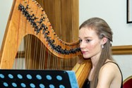 Alexandra Hopkinson playing the harp at Saturday