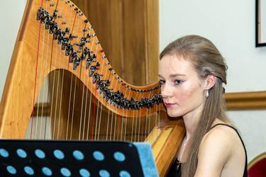 Alexandra Hopkinson playing the harp at Saturday's event at the Last Drop