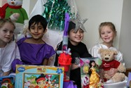 The Infants with some of the toys they have collected