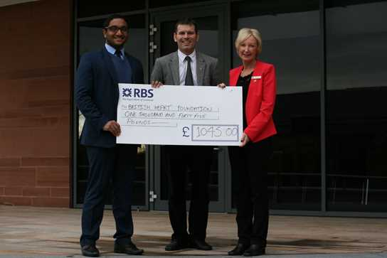 Ahmed Kazie, Y12 member of the BD charities committee presented a cheque