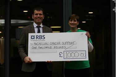 Dr Mullins presents the cheque to Rose Tipton of Macmillan