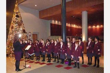 The Junior Girls sing festive hits in the foyer
