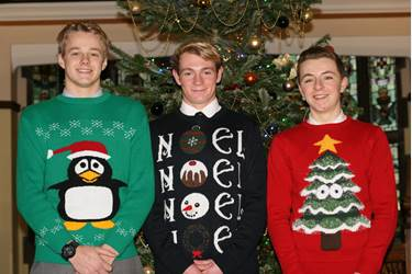 Three of the Sixth Form Boys in their festive attire