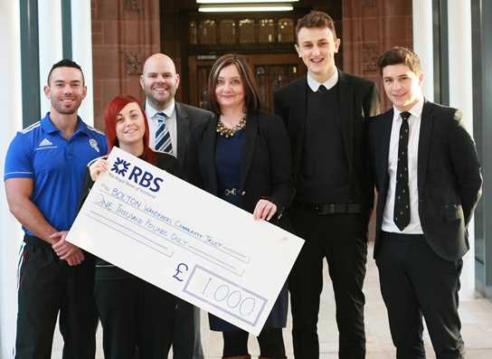 BWCT representatives receive the cheque from Miss Heather Tunstall, Head of Year 12, and two Sixth Form students