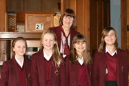 Mrs Haslam and the four Year 7 readers - all in uniform