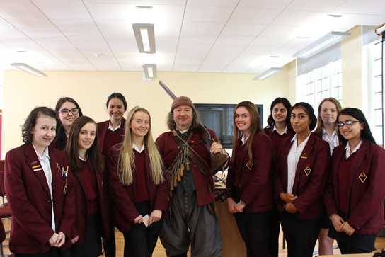 GCSE pupils with an English Civil War musketeer