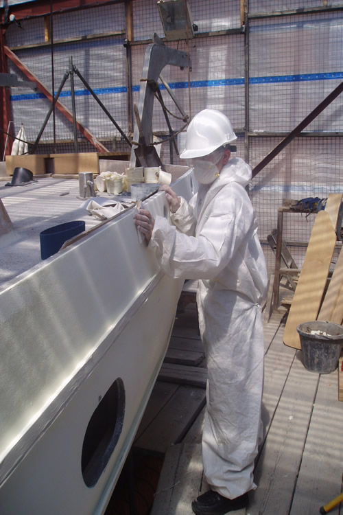 boat-rubbing-down-the-topsides