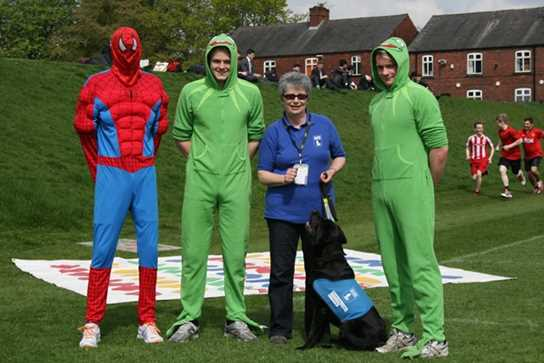 Heather Lowe and Digger with three boys in their Fun Run costumes