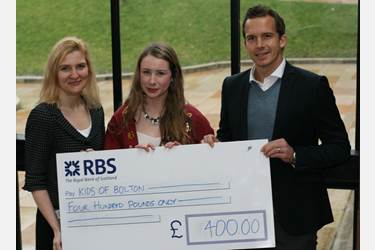 Kevin Davies collects the cheque on behalf of KiDs of Bolton