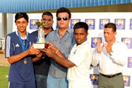 Haseeb shares the three-day match trophy with Sri Lanka Captain Charith Asalanka as it is presented by Dunston Goluhewa (SLC ExCo Member)