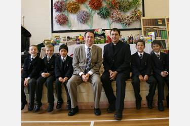 Mr Whittaker and the boys with Reverend Cornes