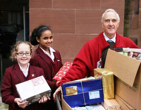 Girls hand over their boxes to David Hall