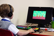 Bolton School Infants pupil studying ICT