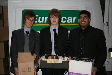 Sixth Form boys hand over used textbooks to Read International
