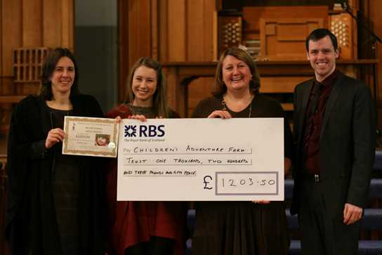 Julie received the cheque from Miss Marrs, prefect Hannah Wylie and Mr Radcliffe