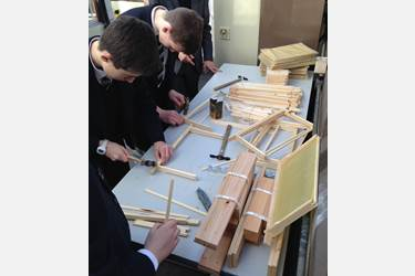 The boys get busy building the frames in preparation for the bees