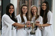 Radhika Sharma, Maddy King, Miriam Harrisson and Katie Nightingale with their trophy