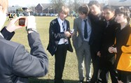 Boys conduct interviews
