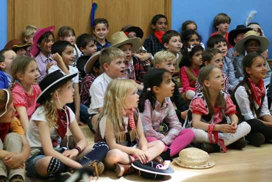 The Year 2 children learning a powwow song