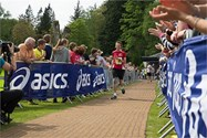 The crowds cheered Charles as he approached the finish line
