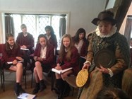 Mistress Mary shows the girls different styles of Tudor plate