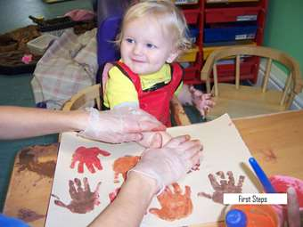 First Steps enjoying hand printing with Autumn colours