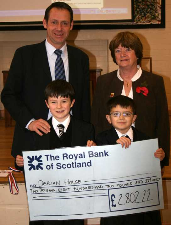 Year three pupils hand over the cheque