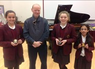 Year 6 Piano winners Jessica Curtis-Walker, Sana Riaz and Charlotte Hughes with adjudicator Mr Jonathan Middleton
