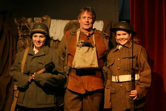 Dave Thirlwall and two of the Year 10 girls, wearing German and British army uniforms
