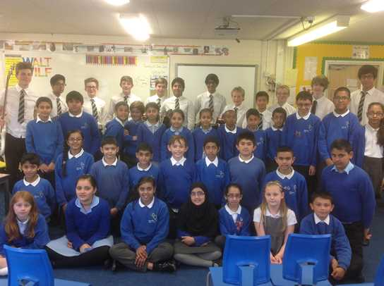 Bolton School musicians with Brownlow Fold Primary School pupils