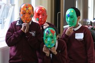 Some of the children show off their finished masks