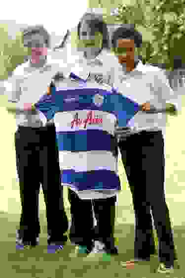 Cian Spencer-McDermott, Joshua Stephenson & Jameson Goloba with the shirt given to Josh by QPR's Ravel Morrison