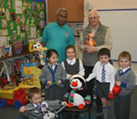 Pupils present the Bolton Lions with a big haul of presents