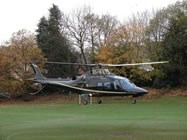 The Nevilles arrive in an Agusta 109 Grand Helicopter
