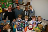 Bolton Lions collect a huge haul of Christmas presents that will be delivered to needy children in the area