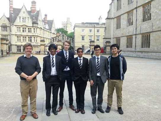 The four boys who entered the German Olympiad with Old Boys Peter Swift and Dean Khan in Exeter College Quad