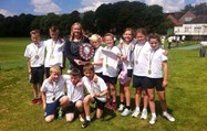 The Claypool School pupils with their medals, and Miss Gorner holding their trophy