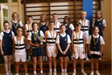 The winning Bolton School Combined Team show off the winners' cup