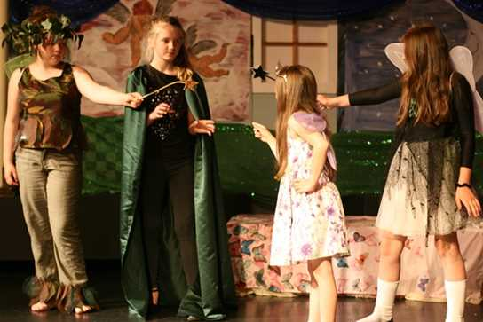 Puck and Oberon face off against Titania and her fairies