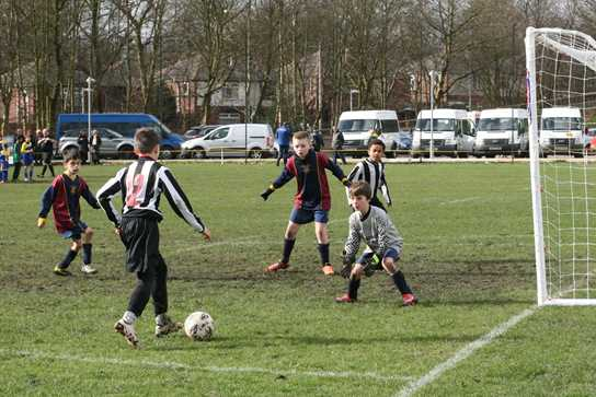 One of the Bolton School boys lining up for a goal during an earlier match